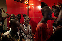 DAKAR, SENEGAL-JUNE 19: Models wait backstage before a show at Dakar Fashion Week on June 19, 2014, at theatre Sorano in Dakar, Senegal. Seventeen Senegalese, African and foreign-based designers showed their collections during the 12th edition of Dakar Fashion week. The evening's event showcased a fashion film produced by designer Adama Paris and installation fashion show. (Photo by Per-Anders Pettersson)