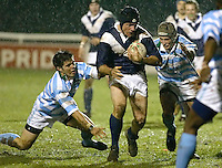 Cambridge University / Oxford University..Pcubed 23rd Rugby League Varsity match..The Athletic Ground, Richmond, March 5, 2003..Pic : Max Flego... Oxfords J Allen escapes the attentions of two Cambridge players