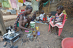 Josephine Daniel and her children eat a breakfast of tea and bread in a camp for more than 12,000 internally displaced persons located on the grounds of the Roman Catholic Cathedral of St. Mary in Wau, South Sudan. Most of the families here were displaced in June, 2016, when armed conflict engulfed Wau.<br /> <br /> Norwegian Church Aid, a member of the ACT Alliance, has provided relief supplies to the displaced in Wau, and has supported the South Sudan Council of Churches as it has struggled to mediate the conflict in Wau.