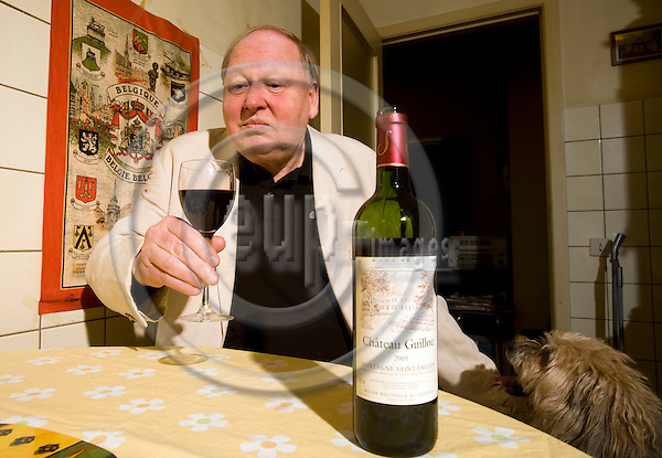 BRUSSELS - BELGIUM - 22 MARCH 2008 --  Journalist Lennart ANEBÄCK (Aneback) with a bottle Chateau Guillon wine and his dog. Photo: Erik Luntang/EUP-IMAGES