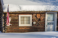 Rustic mining cabin in the winter in the small community of Livengood, Alaska.