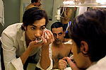 Tango dancers make their last preparations before performing on stage tango, at Esquina Carlos Gardel, a restaurant who offers dinner with tango shows, at the Abasto Market, in Buenos Aires, April 29, 2003...The restaurant is located on the site of a former Gardel hangout, Chanta Cuatro, after dinner a tango band takes the stage on the balcony as tango dancers flash around the stage.  Photo by Quique Kierszenbaum..