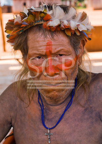Pará State, Brazil. Aldeia A-Ukre (Kayapó). Kupatu Kayapó with feather headdress.
