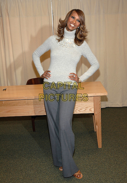 "IMAN.Signs copies of her new book, ""The Beauty Of Color"" at the Barnes & Noble Bookstore on 5th Avenue in Manhattan, New York, New York. .October 17th, 2005.Photo Credit: Patti Ouderkirk/AdMedia/Capital Pictures.Ref: PO/ADM.full length hands on hips grey gray trousers sweater turtleneck polo neck.www.capitalpictures.com.sales@capitalpictures.com.© Capital Pictures."