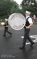 Bass Drummer of Pollok Young Loyalist Flute Band leading Govan District returning from the County Grand Orange Lodge of Glasgow Parade 2012 which took place in Glasgow on 7.7.12..