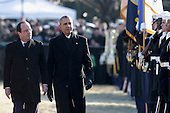 United States President Barack Obama (R) walks with French President Francois Hollande during a welcoming ceremony on the South Lawn at the White House on February 11, 2014 in Washington, DC. Hollande who arrived yesterday for a three day state visit, visited Thomas Jefferson's Monticello estate and will be the guest of honor for a state dinner tonight.  <br /> Credit: Chip Somodevilla / Pool via CNP