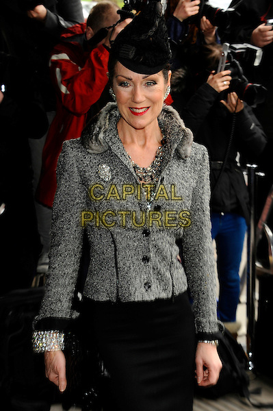 Lorraine Chase.The TRIC ( TV & Radio Industries Club ) Awards, Grosvenor House Hotel, Park Lane, London, England..13th March 2012.half length black skirt hat grey gray jacket.CAP/CJ.©Chris Joseph/Capital Pictures.