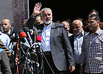 Ismail Haniyeh, leader of Hamas, gives delivers an address during a press conference in Gaza City on May 11, 2017, in which the group announced the arrest of the suspected murderer of one of its key military commanders, Mazen Faqha, who was shot dea don March 24, 2017 near his home in Gaza City. No details were provided on the suspect's identity, though Hamas has previously suggested Palestinian collaborators worked with Israel on the assassination. Photo by Ashraf Amra