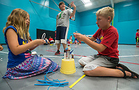 NWA Democrat-Gazette/BEN GOFF @NWABENGOFF<br /> Autumn Stem (from left), 9, Elijah Reader, 11, and Layton Patterson, 10, all of Rogers, make crafts from recyclable materials Friday, July 6, 2018, during the Rogers Activity Center summer day camp. Autumn and Layton made a basketball trophy and Elijah made a figure he described as a 'crazy, weird guy.'