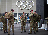 18.07.2012. London, England.  Soldiers stand guard under the Olympic rings at the Olympic Park in London, Britain, 18 July 2012. The London 2012 Olympic Games will start on 27 July 2012.