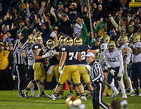 Golson and teammates celebrate the 3OT victory.