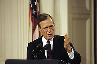 Washington DC., USA, June 4, 1992<br /> President George H.W. Bush answers reporters questions. This was after his meeting with Prime Minister Eugenia Charles and Other Eastern Caribbean leaders during an official visit of those leaders to the White House. Credit: Mark Reinstein/MediaPunch