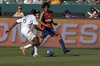 LA's Quavas Kirk defends against RSL's Medhi Ballouchy. The Los Angeles Galaxy defeated Real Salt Lake, 3-2, at the Home Depot Center in Carson, CA on Sunday, June 17, 2007.