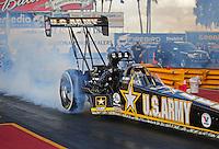 Jan 24, 2009; Chandler, AZ, USA; NHRA top fuel dragster driver Tony Schumacher does a burnout during testing at the National Time Trials at Firebird International Raceway. Mandatory Credit: Mark J. Rebilas-