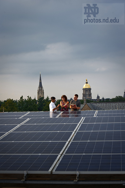 Professor Prashant Kamat, left, works with graduate students on the solar panels on the roof of Stinson-Remick Hall of Engineering...Photo by Matt Cashore/University of Notre Dame