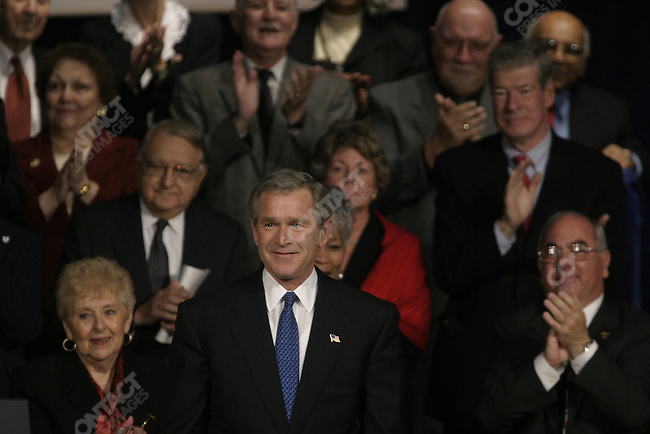 President Bush is surrounded by Congressional leaders, and members of the Senior community as he signs into law the most far-reaching changes in Medicare since it began nearly 40 years ago, at the Daughters of the American Revolution's Constitution Hall in Washington.  Here he is surrounded by Sen. Max Baucus (D-MT), Sen. Charles Grassley (R-IA), Senate Majority Leader Bill Frist (R-TN), Speaker of the House Denis Hastert (R-IL), Sen. John Breaux (D-LA), House Majority Leader Tom Delay (R-TX), Rep. William Thomas (R-CA) and congresswoman Nancy Johnson (R-CT). Washington, D.C. December 8, 2003