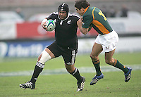 New Zealand tight head Ben Afeaki fends off South African centre Stephan Dippenaar during the U19 Championship final against South Africa at Ravenhill, Belfast.