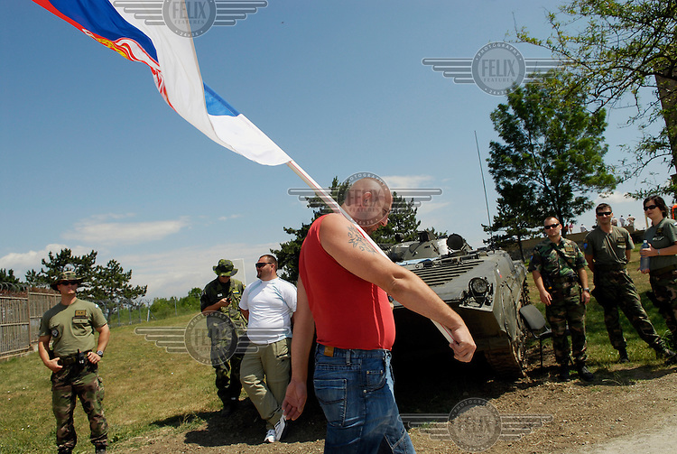 A Serb man arrives at the Gazemestan monument for a religious service in commemoration of the Battle of Kosovo Field in 1389. Every year Serbs visit the site to hold a religious ceremony commemorating the battle, which they lost, and which they see as the moment when they lost control of their country and the Balkans to the Muslim Ottoman Empire which was in control for the next 500 years.