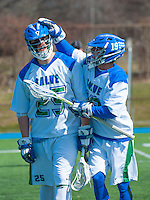 Sharp Jones,'16, left,  is congratulated by teammate Dana Sundell,'19, after scoring on Endicott during Men's Lacrosse game action at Gaudet Field in Middletown.