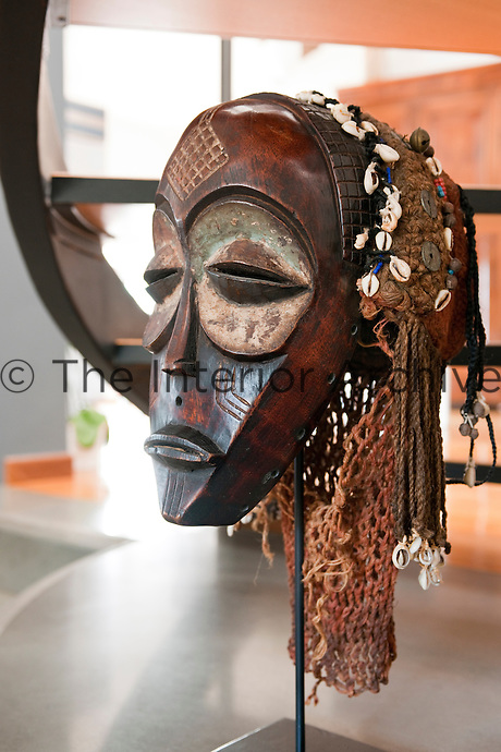 Close up of a Congo mask Mbagani, part of a large collection displayed throughout the house