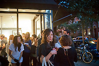 Hordes of shoppers descend on the trendy Bleecker Street outside of the Mark Jacobs store in New York on Thursday, September 6, 2012 during the fourth annual Fashion's Night Out event. On the first evening of New York Fashion Week stores around the city offer sales and bargains as well as parties and events to entice customers to shop. The event has been so successful in boosting sales that over 100 cities in the US are having their own events, and Fashion's Night Out events occur in fashion-forward cities around the world. (© Richard B. Levine)