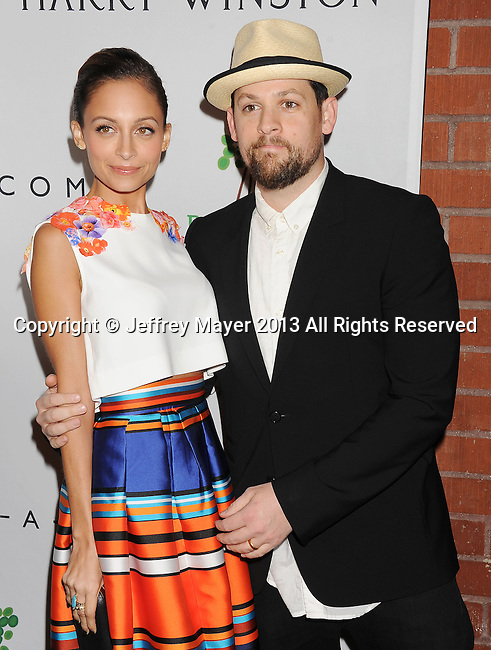 CULVER CITY, CA- NOVEMBER 09: Musician/singer Joel Madden (R) and TV personality/wife Nicole Richie arrive at the 2nd Annual Baby2Baby Gala at The Book Bindery on November 9, 2013 in Culver City, California.
