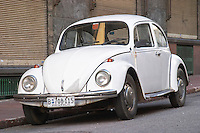 An old white Volkswagen Beetle probably from the 1960s parked on the street in the city Plaza Independencia Independence Square Montevideo, Uruguay, South America