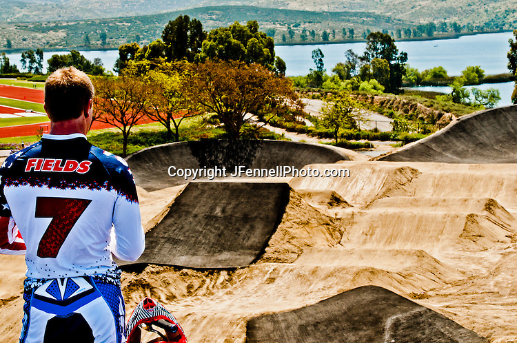 Connor Fields observing the track from atop the starting gate platform, on the London Replica BMX track at the US Olympic Training Center in Chula Vista, CA