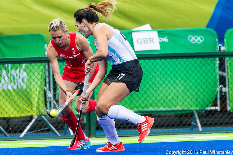 Alex Danson #15 of Great Britain flips the ball past Rocio Sanchez #17 of Argentina during Argentina vs Great Britain in women's Pool B game  at the Rio 2016 Olympics at the Olympic Hockey Centre in Rio de Janeiro, Brazil.