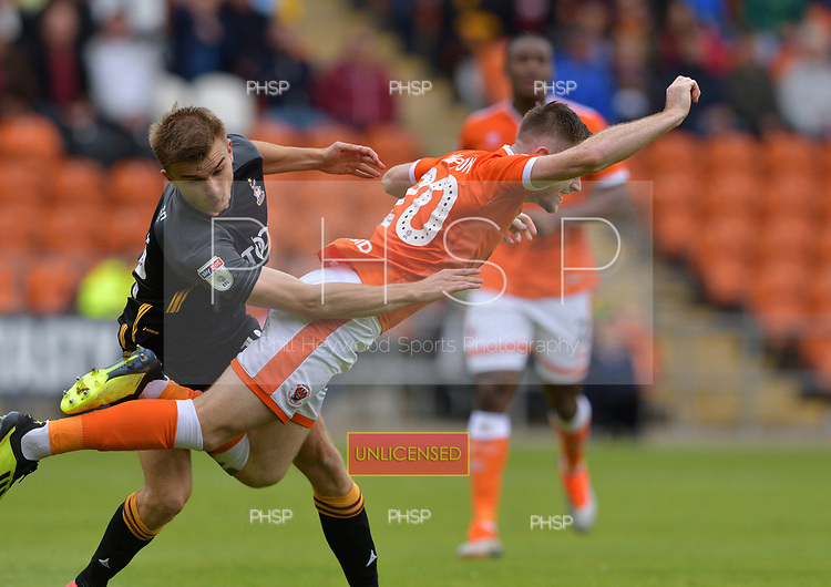08/09/2018 Sky Bet League 1 Blackpool v Bradford City<br /> <br /> George Miller fouls Ollie Turton