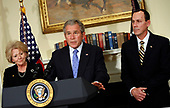 United States President George W. Bush makes a statement on aviation congestion in the Roosevelt Room of the White House in Washington, DC on November 15, 2007.  Standing with the President are Robert A. Sturgell, Deputy Administrator of the Federal Aviation Administration, right, and US Secretary of Transportation Mary Peters, left. <br /> Credit: Aude Guerrucci / Pool via CNP