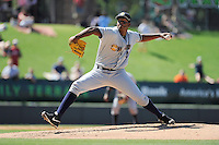 Pitcher Rony Bautista (40) of the Charleston RiverDogs delivers a pitch in a game against the Greenville Drive on Sunday, June 28, 2015, at Fluor Field at the West End in Greenville, South Carolina. Charleston won, 12-9. (Tom Priddy/Four Seam Images)