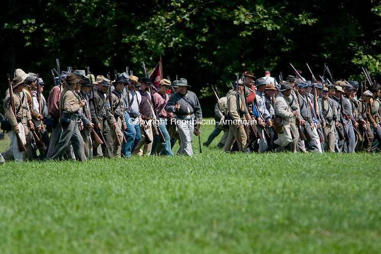 WOODBURY, CT - 16 AUGUST 2009 -081609JT17-<br /> FOR COUNTRY LIFE: Men portraying Confederate soldiers reenact the Civil War Battle of 3rd Winchester at Three Rivers Park in Woodbury on Saturday.<br /> Josalee Thrift Republican-American