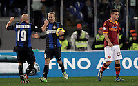 Calcio, semifinale di andata di Coppa Italia: Roma vs Inter. Roma, stadio Olimpico, 23 gennaio 2013..FC Inter forward Rodrigo Palacio, of Argentina, center, celebrates with teammate Esteban Cambiasso, also of Argentina, after scoring as AS Roma midfielder Alessandro Florenzi, right, reacts during the Italy Cup football semifinal first half match between AS Roma and FC Inter at Rome's Olympic stadium, 23 January 2013..UPDATE IMAGES PRESS/Riccardo De Luca