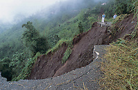 Tourists look at Road washout after Mud slide, Blue Mountains, Jamaica, January 2005