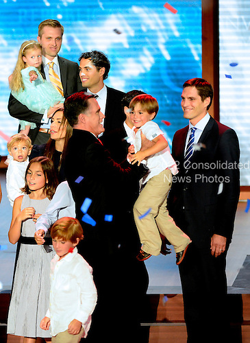 Mitt Romney, Republican nominee for President of the United States picks-up a member of his family following his remarks at the 2012 Republican National Convention in Tampa Bay, Florida on Thursday, August 30, 2012.  .Credit: Ron Sachs / CNP.(RESTRICTION: NO New York or New Jersey Newspapers or newspapers within a 75 mile radius of New York City)