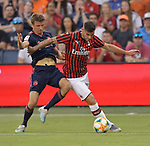 Thomas Muller (25, left) of Bayern Munich vies for the ball with Theo Hernandez (19) of Milan during their International Champions Cup match on July 23, 2019 at Children's Mercy Park in Kansas City, KS.<br /> Tim VIZER/AFP