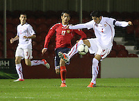 Levent Gulen controls the ball under pressure from Andranik Kocharyan in the Armenia v Switzerland UEFA European Under-19 Championship Qualifying Round match at New Douglas Park, Hamilton on 11.10.12.