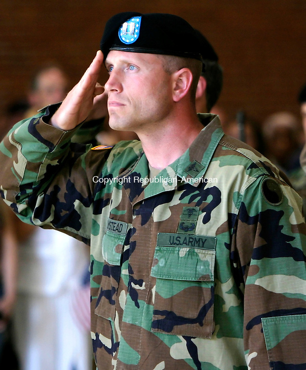 WATERBURY, CT--15 JUNE 2006 -061506JS14- Cpt. Cory Alan Olmstead of Wolcott salutes during the National Anthem during a send off ceremony for the Connecticut National Guard's 143rd Combat Sustainment Support Battalion Thursday at the Waterbury Armory. 70 members of the group will be deployed to Iraq for 18 months following training at Fort Dix in New Jersey. -- Jim Shannon Republican-American