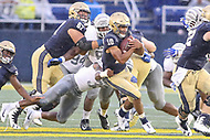 Annapolis, MD - September 8, 2018: Navy Midshipmen quarterback Malcolm Perry (10) gets tackled during the game between Memphis and Navy at  Navy-Marine Corps Memorial Stadium in Annapolis, MD.   (Photo by Elliott Brown/Media Images International)