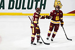 ST PAUL, MN - APRIL 7: Jade Miller #26 congratulates Karson Kuhlman #20 of the Minnesota-Duluth Bulldogs after his goal past Cale Morris #32 of the Notre Dame Fighting Irish during the Division I Men's Ice Hockey Semifinals held at the Xcel Energy Center on April 7, 2018 in St Paul, Minnesota. (Photo by Carlos Gonzalez/NCAA Photos via Getty Images)