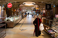 NEW YORK, NY - APRIL 24: A woman wearing a face mask is in front of a food counter at the Grand Central Station market on April 24, 2020 in New York, NY. New York State Governor Andrew Cuomo, during his daily talk on Covid-19, stated that the number of deaths has dropped to its lowest total since April 1. COVID-19 has spread worldwide, causing more than 190,000 lives lost and more than 2.7 million reported infections. (Photo by Pablo Monsalve / VIEWpress via Getty Images)
