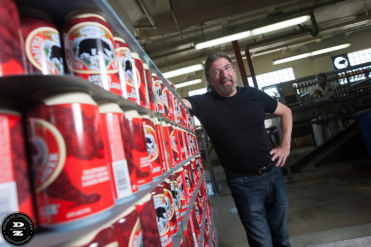 Keith Greggor, president and CEO of Anchor Brewers & Distillers with Anchor Lager cans at the Anchor Steam brewery in San Francisco, Calif.