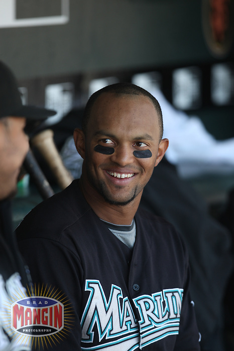 SAN FRANCISCO - JULY 8:  Emilio Bonifacio #1 of the Florida Marlins sits in the dugout against the San Francisco Giants during the game at AT&T Park on July 8, 2009 in San Francisco, California. Photo by Brad Mangin