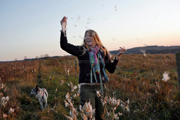 Celia Talbot Tobin with milk weed in an Ithaca field