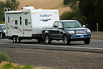Toyota towing travel trailer.