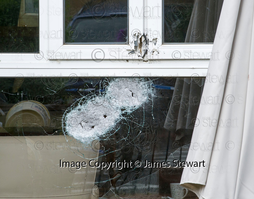 The house at 15 Fernieside Avenue, Edinburgh showing the damage caused when shots were fired early in the morning.