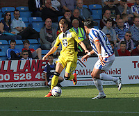 James Marwood runs at Manuel Pascali in the Kilmarnock v St Mirren Scottish Professional Football League Premiership match played at Rugby Park, Kilmarnock on 13.9.14.