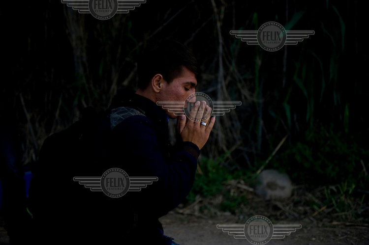 An Afghan refugee prays minutes after landing on the beach near Skala Sykaminias on Lesbos island, Greece.Every day hundreds of refugees, mainly from Syria and Afghanistan, are crossing in small overcrowded inflatable boats the 6 mile channel from the Turkish coast to the island of Lesbos in Greece. Many spend their life savings, over $1,000, to buy a space on these boats.