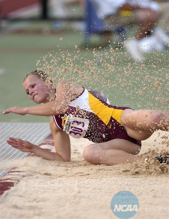 01 JUN  2002:  Fatyana Obukhova (303) of USC competes in the Women's Triple Jump competition during the Division 1 Men's and Women's Track and Field Championship held at Bernie Moore Stadium on the LSU campus in Baton Rouge, LA. Obukhova finished in second place Rich Clarkson/NCAA Photos